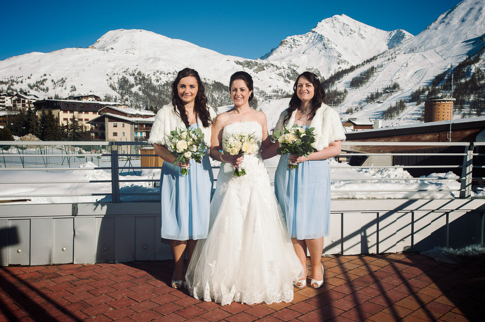 bride and bridesmaids winter wedding on the Alps