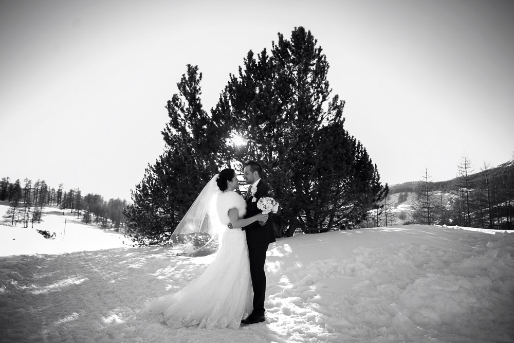bride and groom on snow