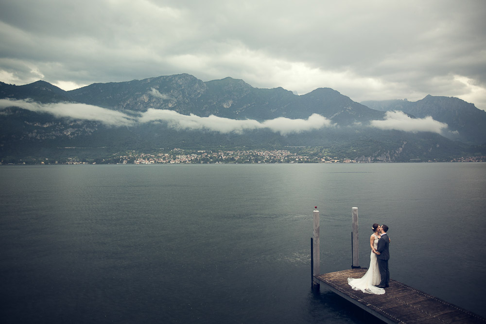 bride and groom by the shores lake Como