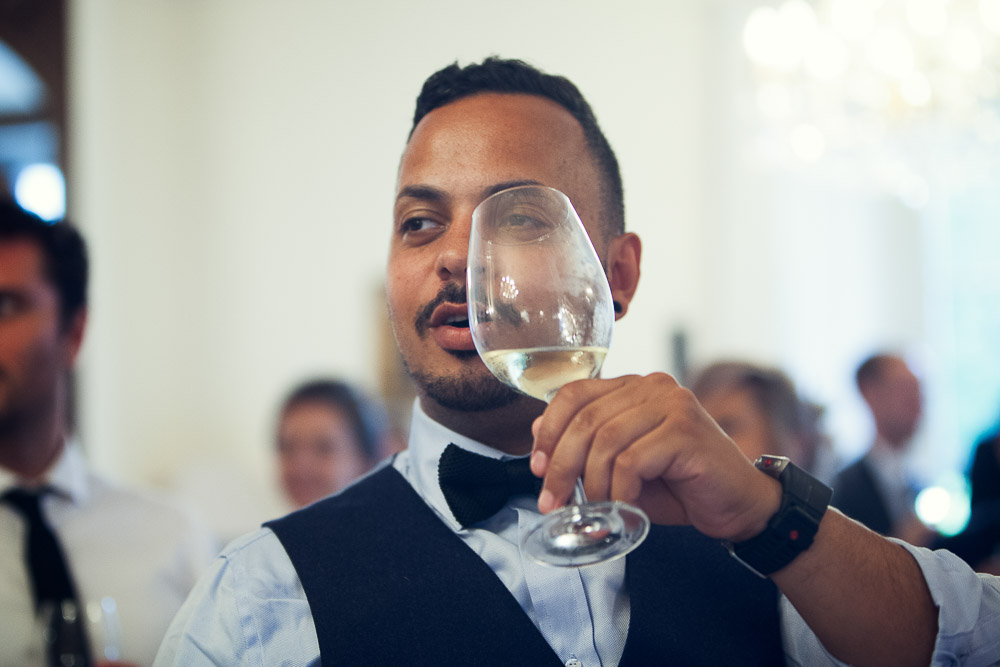guest and his glass of wine