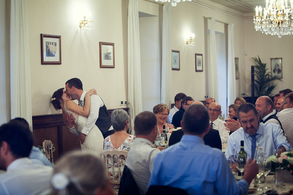 bride and groom kiss at the reception
