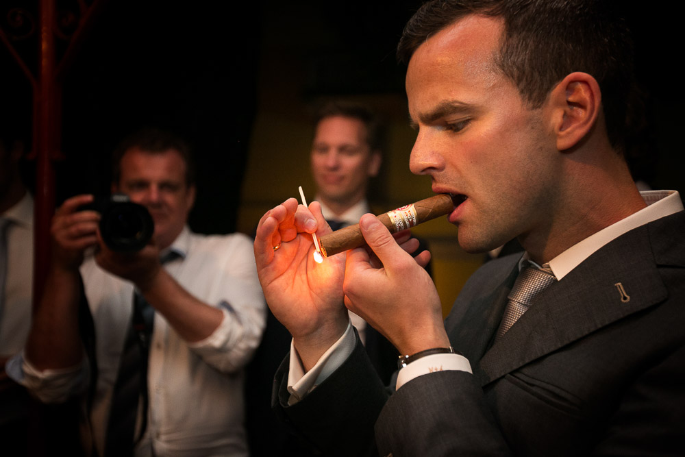 groom's smoking cigars