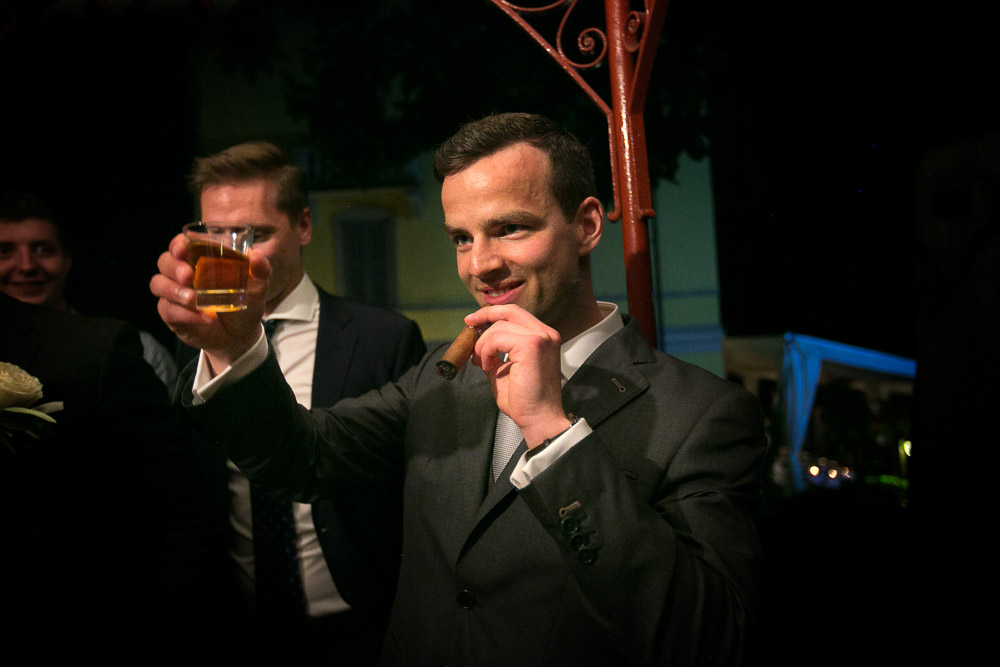 groom with cigar and brandy