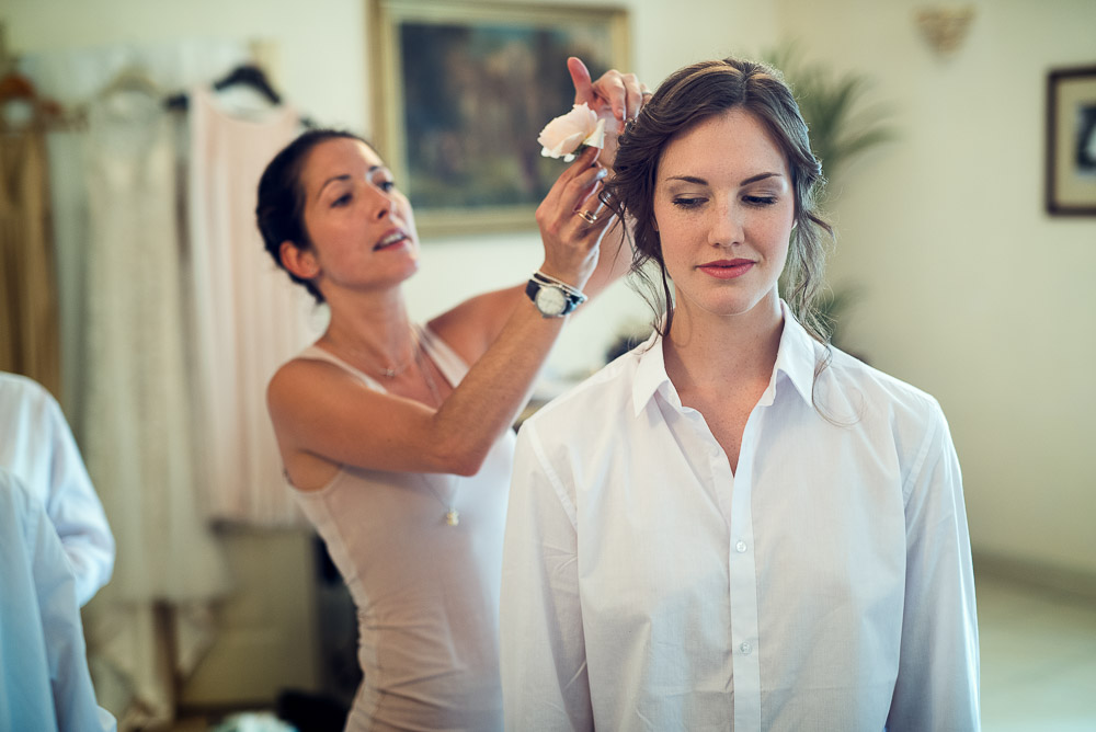 bride's last touches before getting dressed