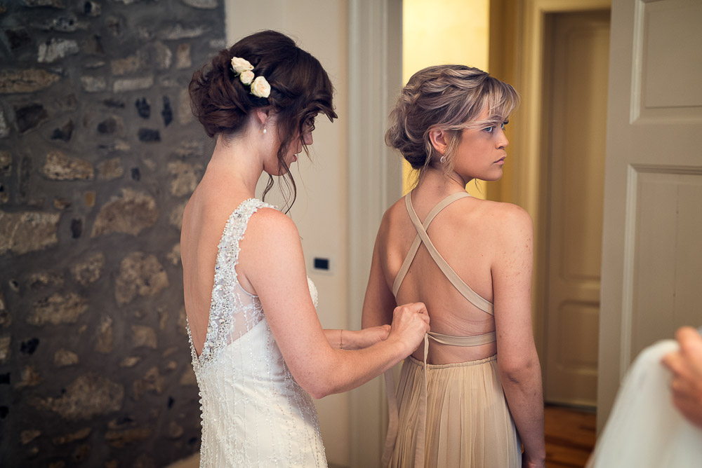 bride and bridesmaid get ready
