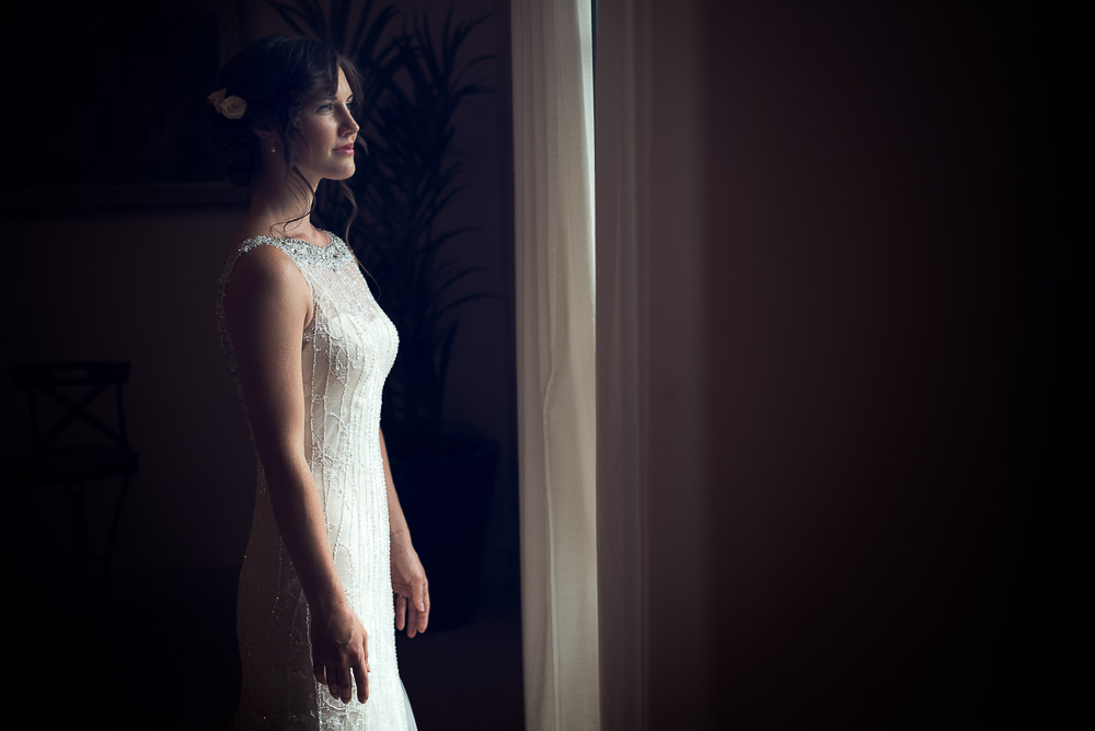 bride is ready looking at the ceremony from her room