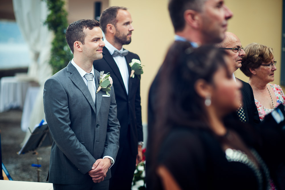groom looks at the bride for the first time