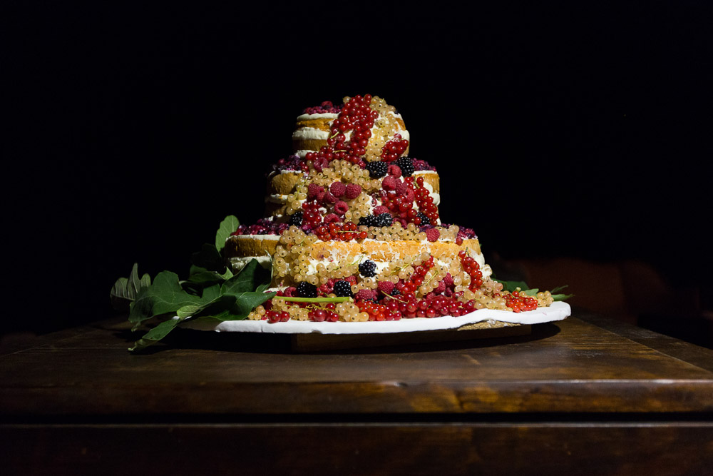 naked wedding cake with currant