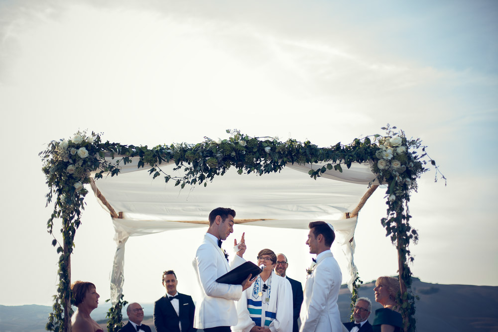 exchanging vows under chuppah