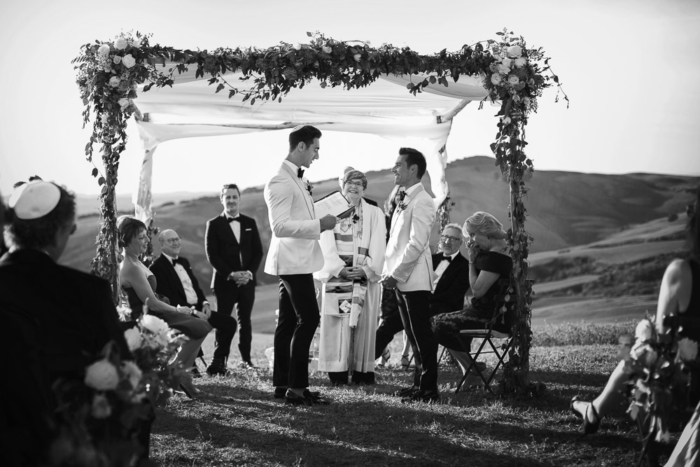 same sex wedding under chuppah