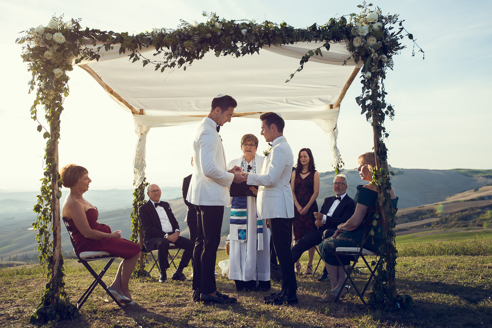 same sex wedding under chuppah in Tuscany Italy