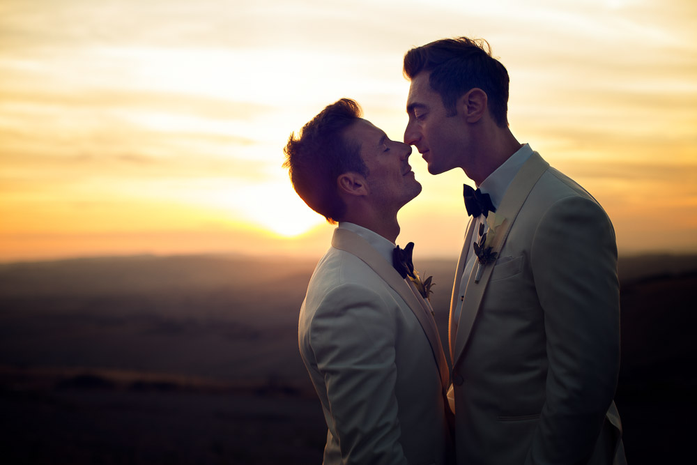 kissing at the sunset in tuscany