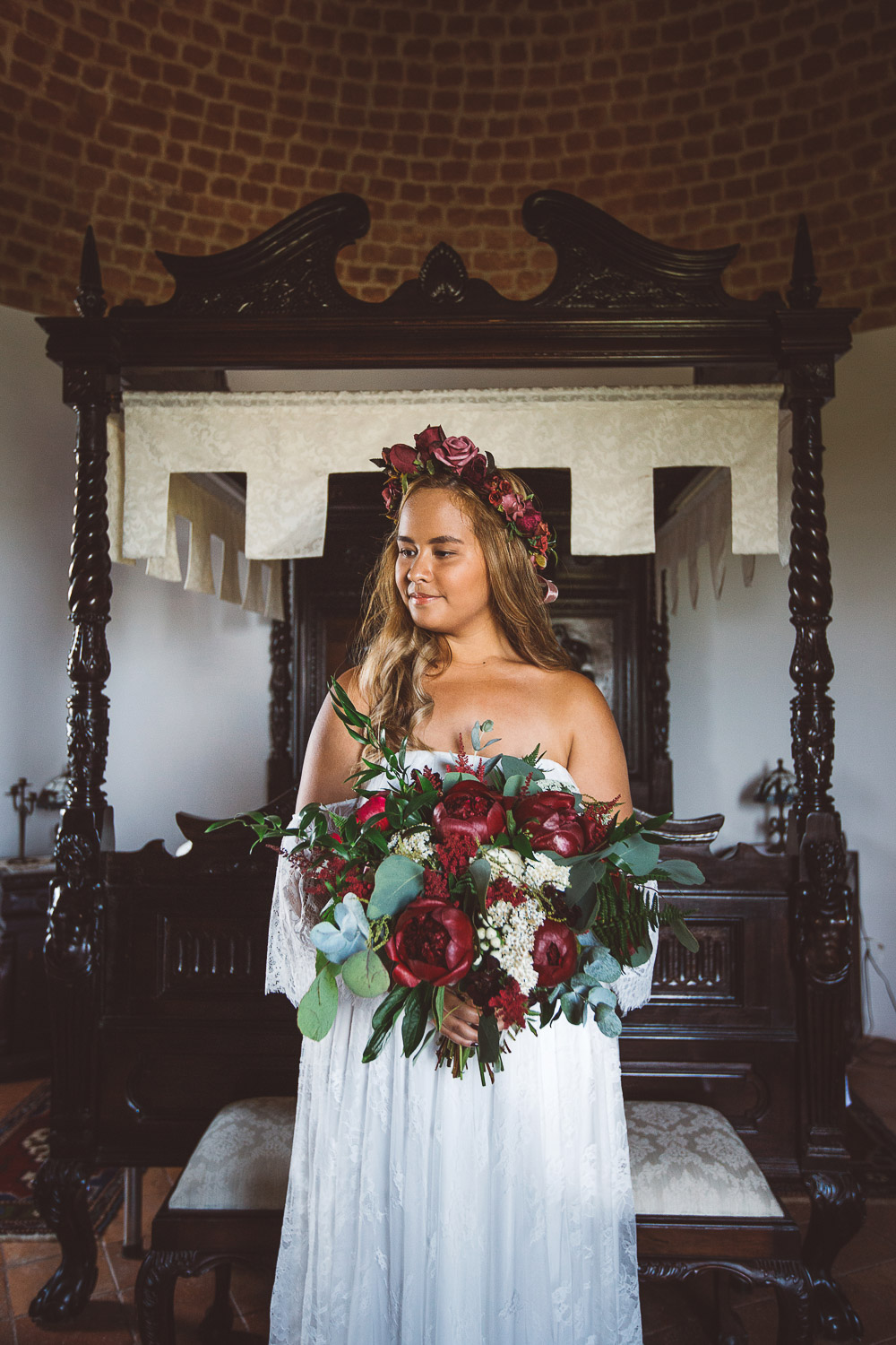 bride with burgundy flowers