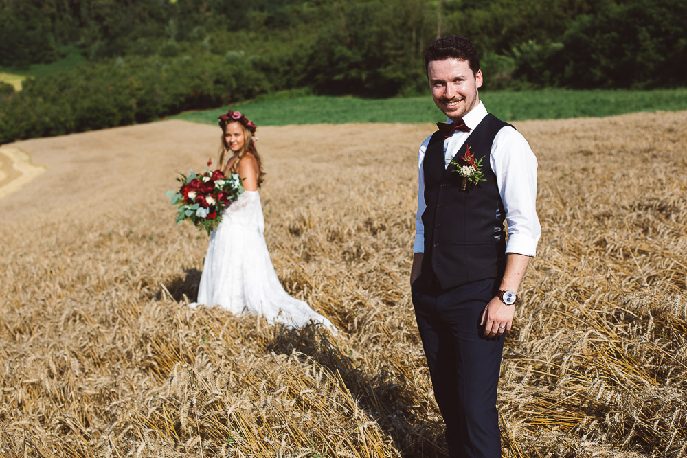 groom and his wife in wheat field