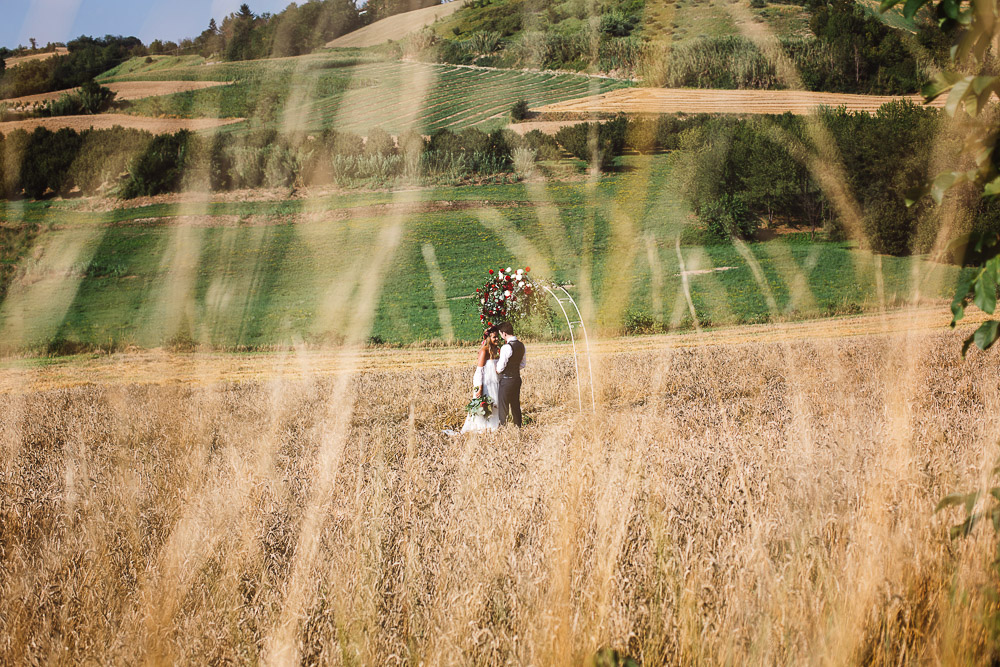 intimate wedding in a wheat field Italy