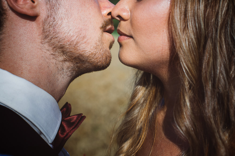 close up bride and groom kiss