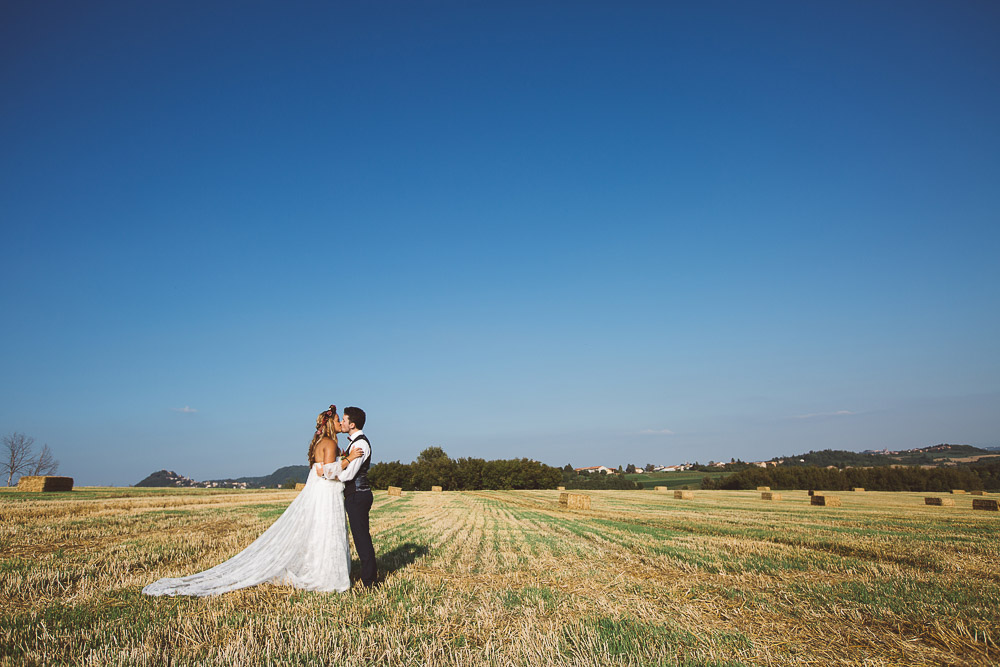 bride and groom and Monferrato hills in Italy