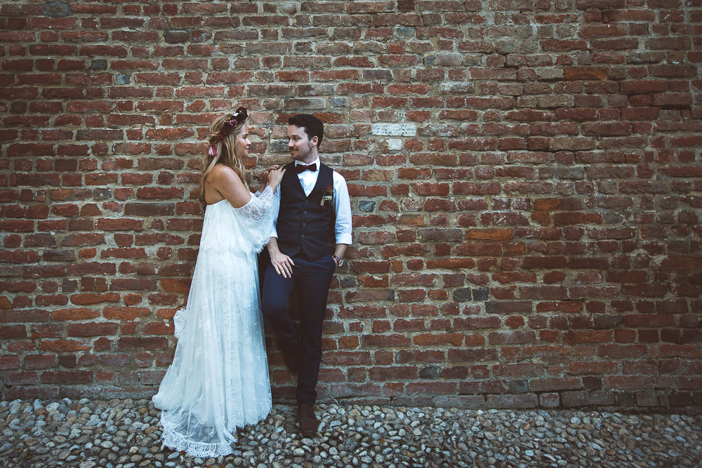 bride and groom and medieval walls