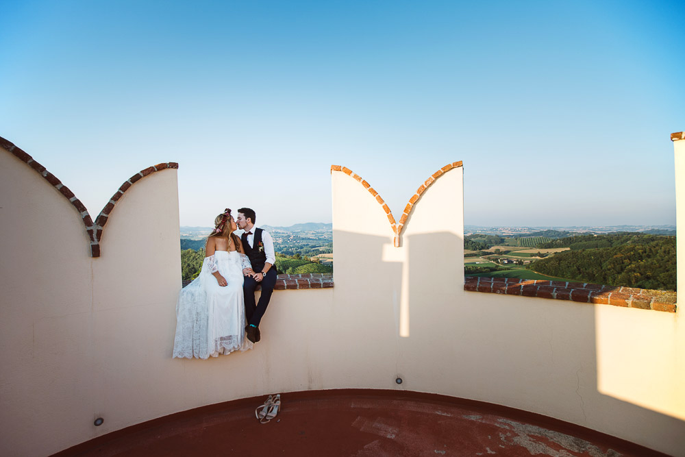 Bride and groom sitting in a Medieval tower in Italy