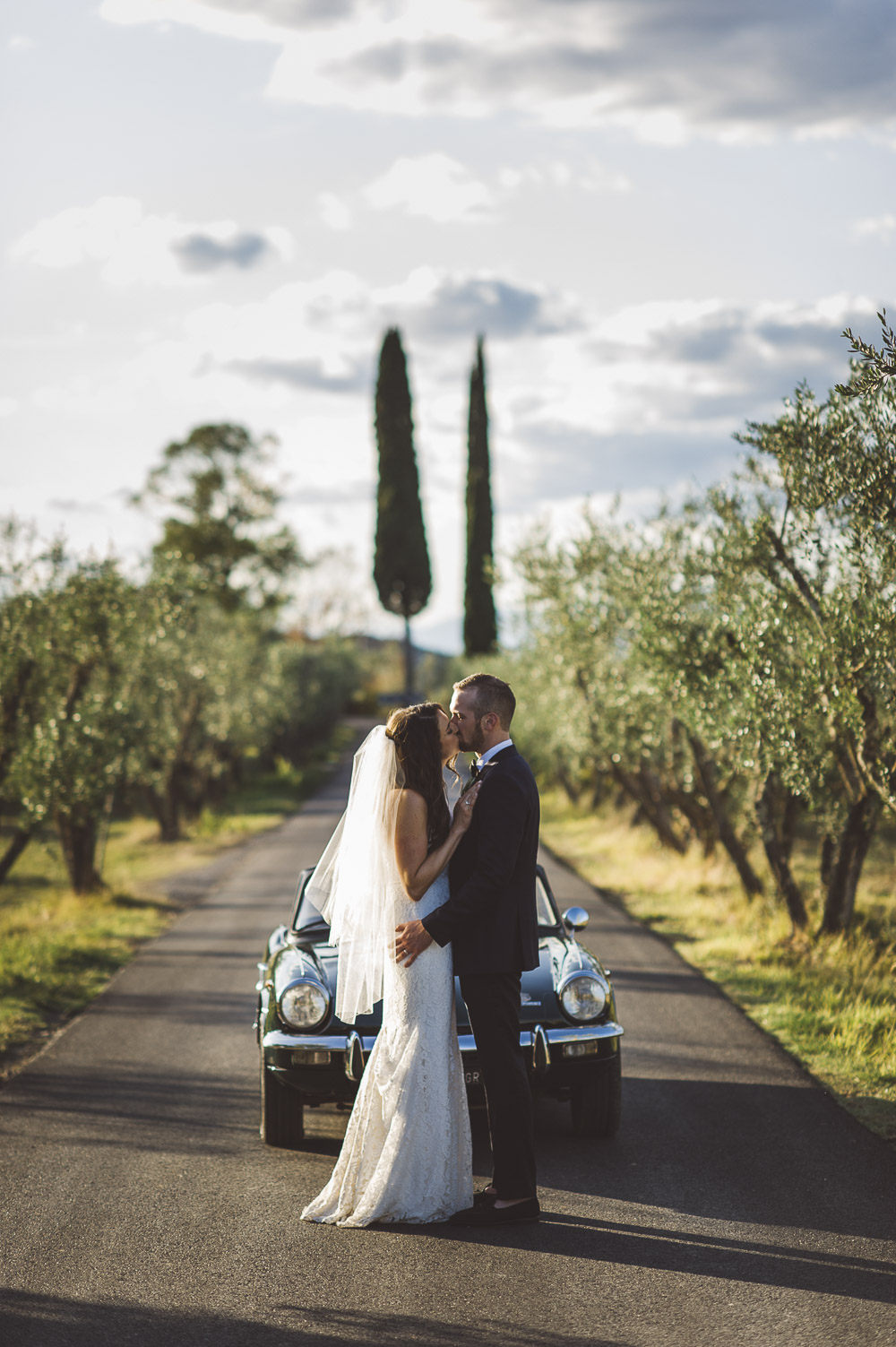 wedding in Tuscany, bride and groom and olive trees