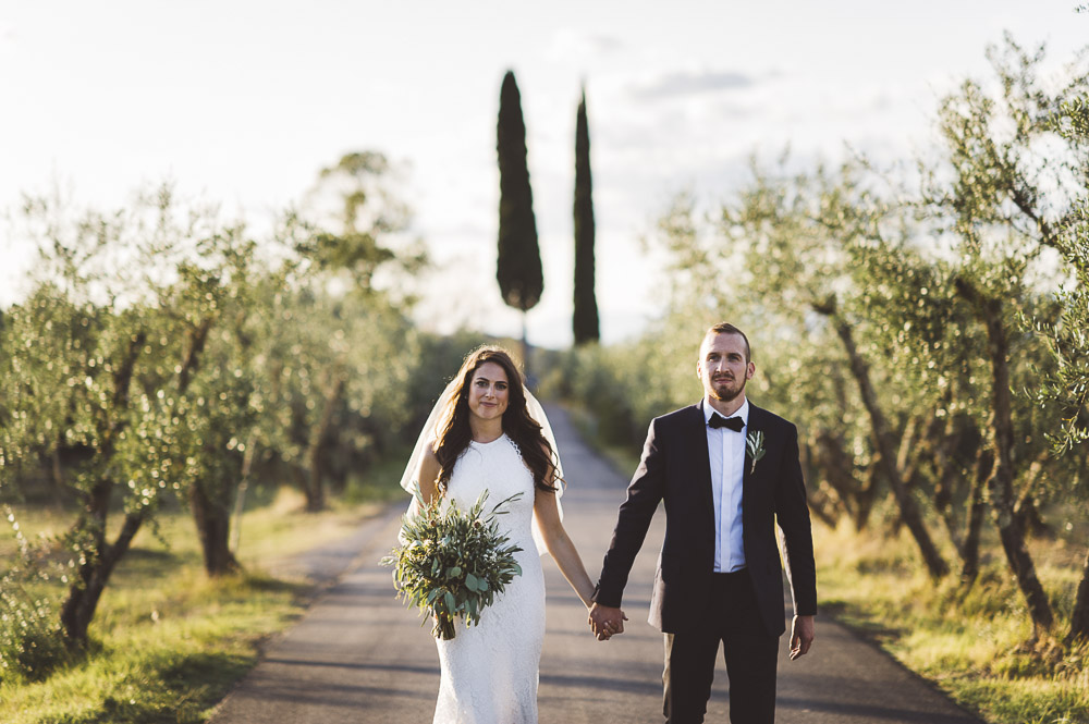 wedding in Tuscany, bride and groom walking