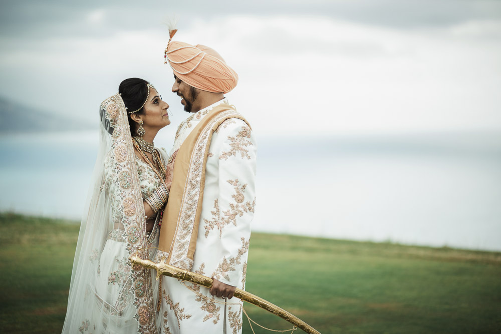 Indian bride and groom in Italy by the sea